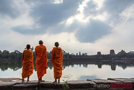 Cambodia, Angkor Wat. Monks in front of temple
