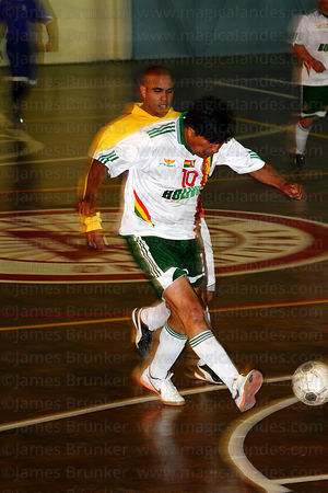 Bolivian president Evo Morales shoots for goal at a futsal tournament, La Paz, Bolivia