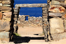 Stone doorway and window in the Chincana Inca ruins, Sun Island, Lake Titicaca, Bolivia