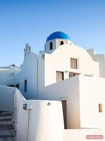 White buildings and blue church in Oia Santorini Greece