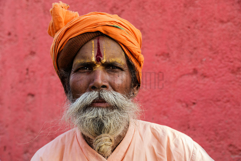 Portrait of a Sadhu Against a Red Wall