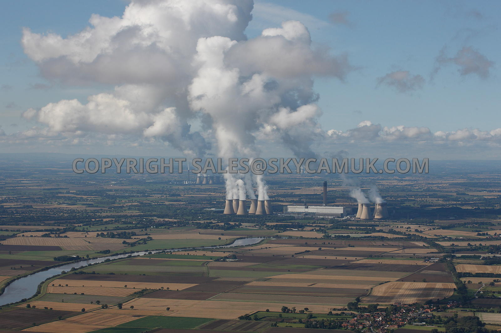 Yorkshire aerial photograph of Three Power Stations venting steam plumes Drax's Eggborough Ferrybridge Stations and River Ouse