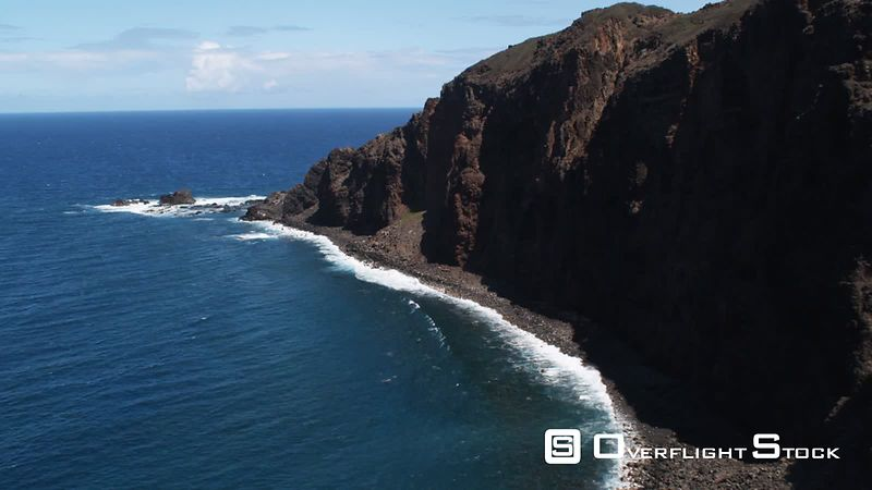 Close flight past cliffs on Molokai, Hawaii.