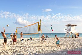 Tourists playing beach volley, Riviera Maya, MExico