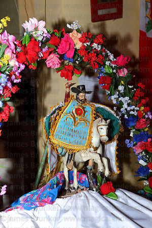 Decorated figure of San Santiago inside church , Taquile Island , Peru