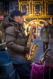 Busker playing the Saxophone in Hamburg