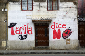 """Tarija Says No"" political mural with cultural symbols on house, Tarija, Bolivia"