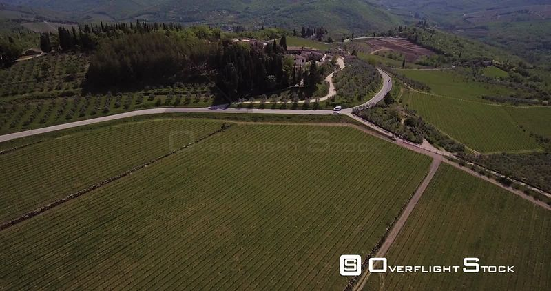 Aerial, beautiful green vineyards in Tuscany hills in Italy