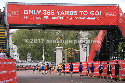 Runners under the 385 yard banner at the London Marathon