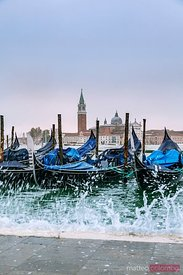 Row of Gondolas with high tide coming, Venice