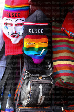 Woollen masks of Kapac Qolla dancers for sale in handicraft shop, Cusco, Peru