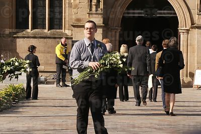 Man with White Roses for the Crowd