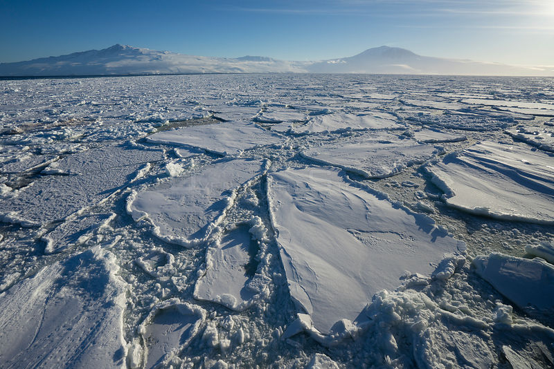 Sea ice, with Mount Terror (left) and Mount Erebus,  Ross Island, Ross Sea, Antarctica.