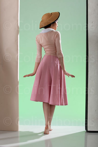 Girl in pink cardigan back view photos
