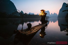 Old chinese fisherman on the river, China