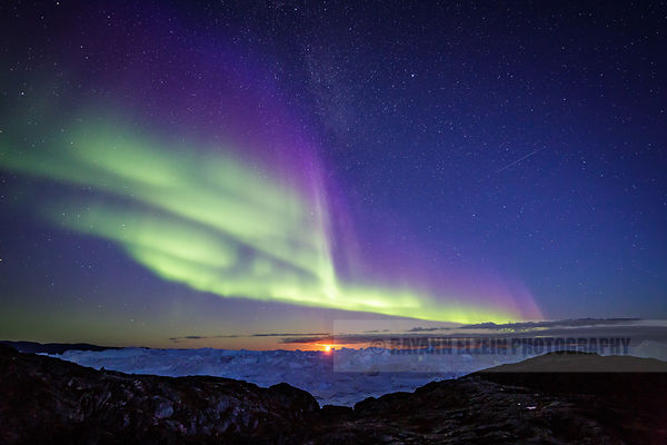 Aurora, Milky Way, full Moon and icebergs at the UNESCO Ilulissat Icefjord in Greenland