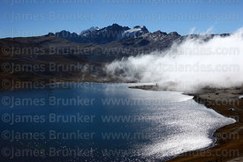 Cloud drifts over Laguna Estrellani, La Cumbre, Cordillera Real, Bolivia