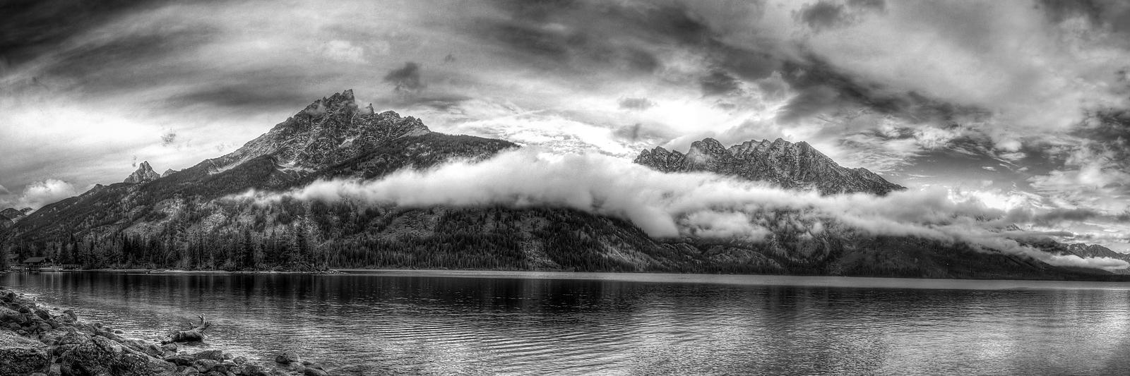 Panoramic of Jenny Lake blanketed in a layer of fog.  Grand Tetons National Park, Wyoming