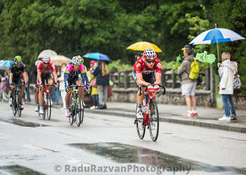 Group of Cyclists Riding in the Rain