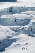 Alpine touring skiers below glacier