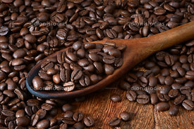 Spoon of Wood with Roasted Coffee Beans