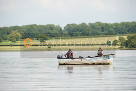 Two fishemen fly fishing from a boat on Rutland Water