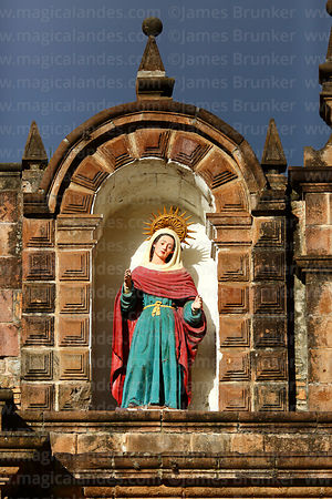 Statue of Santa Ana on top of facade of the Temple of the Holy Family / Templo de la Sagrada Familia, Cusco, Peru