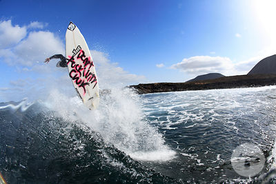 "Watershot of David  ""Don't f&@# wtih Chuck""  Jaio launching a nice frontside  360 on a wave, La Graciosa island, Canary islands, Spain, march 2008."
