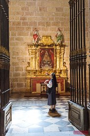A nun inside the cathedral of Segovia, Spain