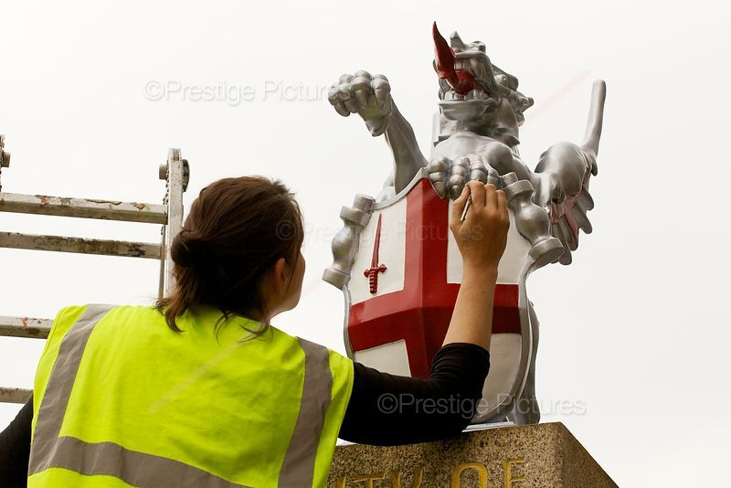 Painter working on the Dragon Statues by London Bridge