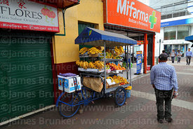 Tricycle fruit cart outside MiFarma chemists, Miraflores, Lima, Peru