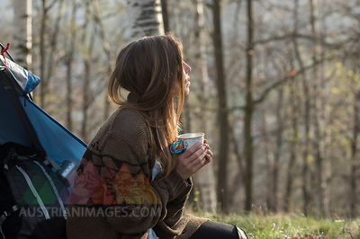 Woman camping in forest