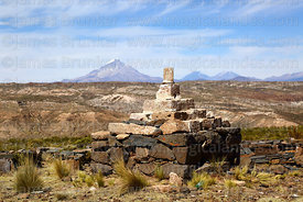 Cairn on summit of Cerro Monterani hill, Sajama volcano in distance, near Curahuara de Carangas, Oruro Department, Bolivia