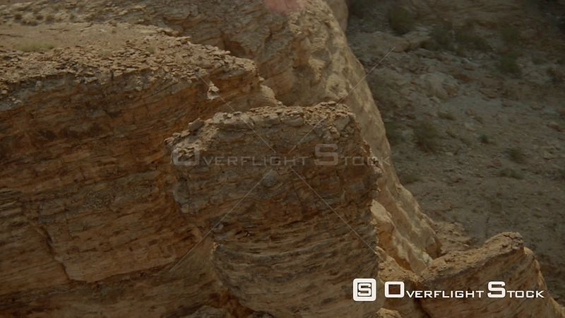 Aerial close up along mountain top of rocky formations, pass gap, wide shot over top to mountain range in background Fish River Canyon Namibia