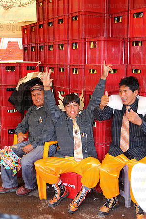 Dance group drinking at party after formal parades, Virgen de la Candelaria festival, Puno, Peru