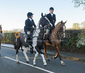 Hilary Butler and Adam Cooke leaving the meet - The Cottesmore Hunt at Pickwell Manor 28/12