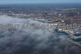 Liverpool aerial photograph of Low lying cloud and fog rolling in over the River Mersey and Liverpool Docks