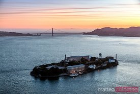 Aerial of Alcatraz and Golden gate bridge at sunset, San Francisco, California, USA