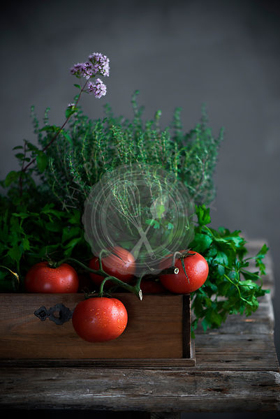 Tomatoes and vegetables in a wooden tray