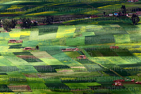 Patchwork quilt fields and farms on Chinchero plateau in rainy season, Cusco Region, Peru