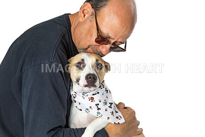 Man Affectionately Holding Scared Rescue Dog