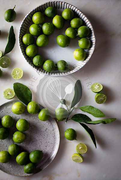 Key lime with leaves in a ceramic bowl