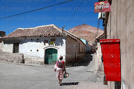 Rustic colonial house, Quechua lady and Cerro Rico, Potosí, Bolivia