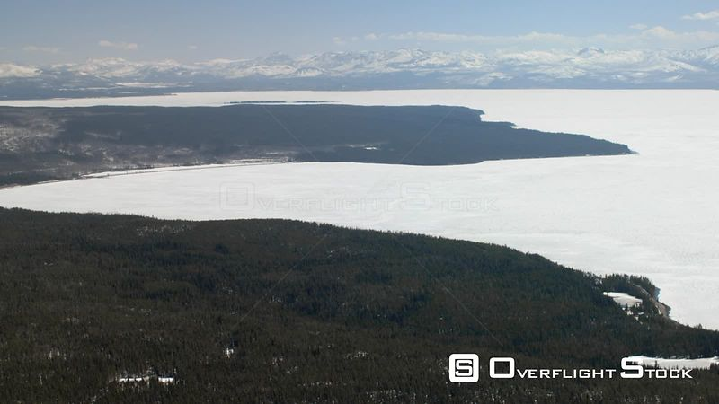 The West Thumb of Yellowstone Lake is ice covered in early Spring, in Yellowstone National Park