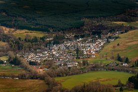 View of the village of Killin in Scotland at dusk from the Tarmachan ridge.