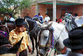 Gauchos drinking maize beer from a tutuma next to his horse during carnival, Canasmoro, Tarija Department, Bolivia