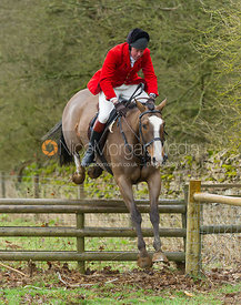 Tom Kingston jumping a hunt jump above Croxton Park