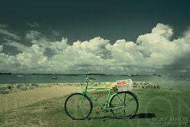 Old bicycle by sea