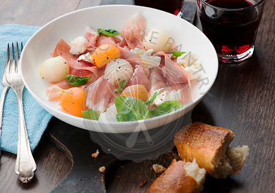 Melon and prosciutto ham salad with Mozzarella