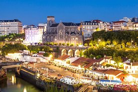 Fishing harbor with restaurants at night, Biarritz, France